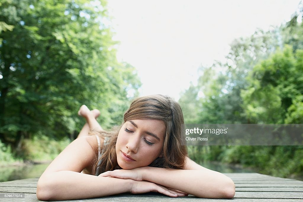 Woman Resting on Dock : ストックフォト