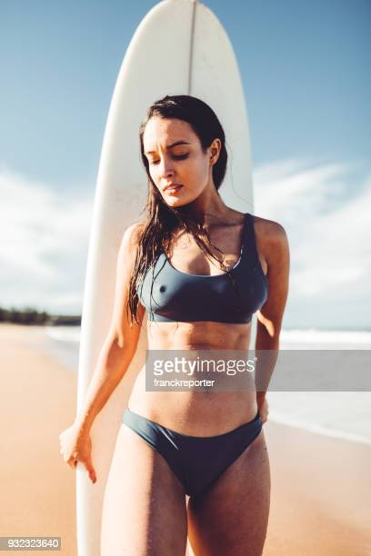 woman resting on the surf board in australia
