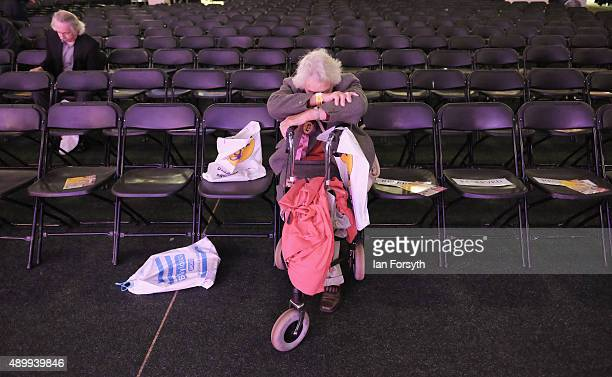 A woman rests as she waits for the conference to start ahead of the UK Independence Party annual conference on September 25 2015 in Doncaster England...