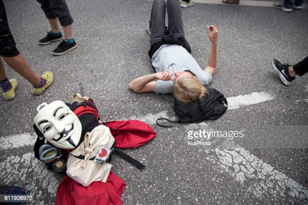 Woman rests during G 20 summit in Hamburg on July 7 2017