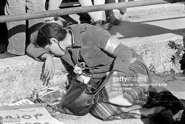 A woman rests during the protest againts Vietnam War San Francisco April 15 1967