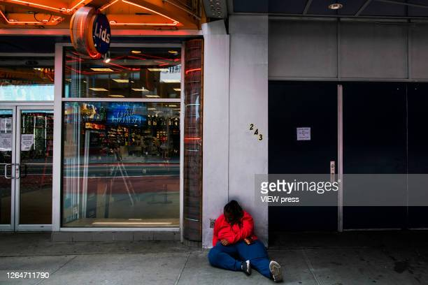 A woman rests in Times Square on August 8 2020 in New York City With more than four months NYC has closed some of their doors to combat the...