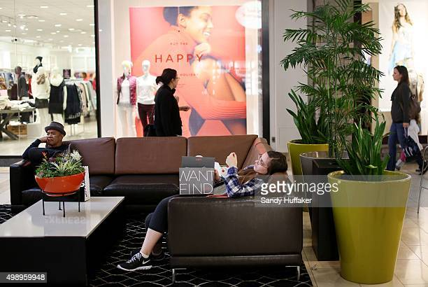 A woman rests on a couch while shopping at the North County Fair Mall on November 27 2015 in Escondido California Although Black Friday sales are...