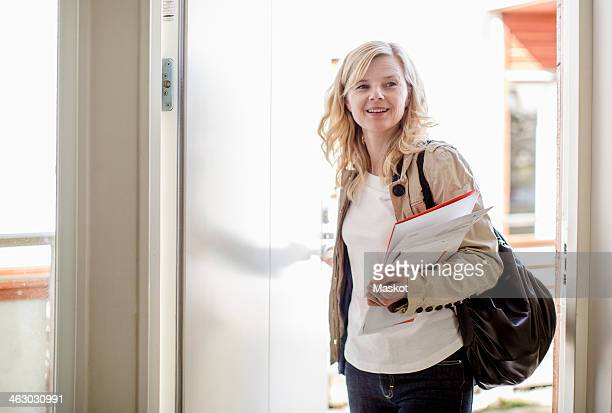Woman returning home from office