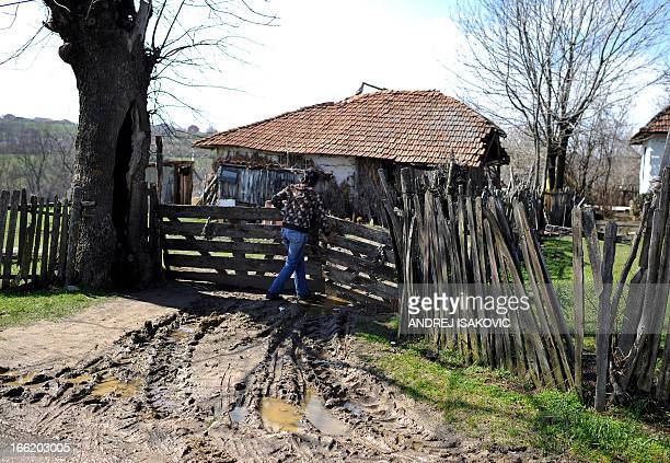 A woman returns to the home of yesterdays shooting victim in the village of Velika Ivanca 40 kilometres south of Belgrade on April 10 2013 Serbia...
