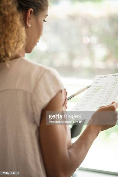 Woman reviewing document