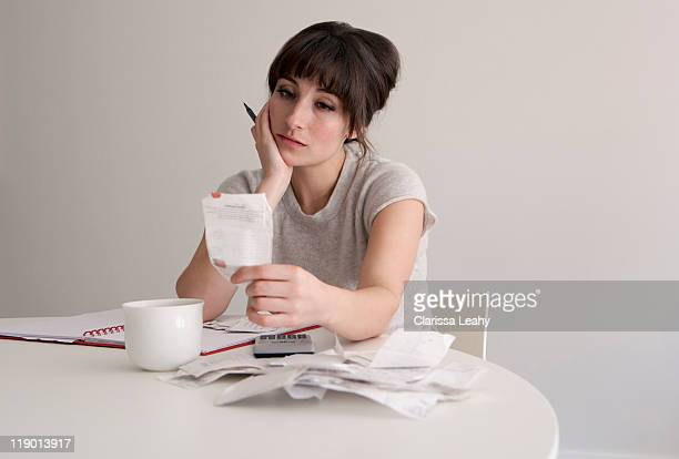 Woman reviewing receipts