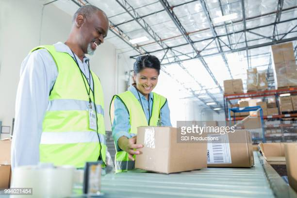 Woman reviews package in distribution warehouse