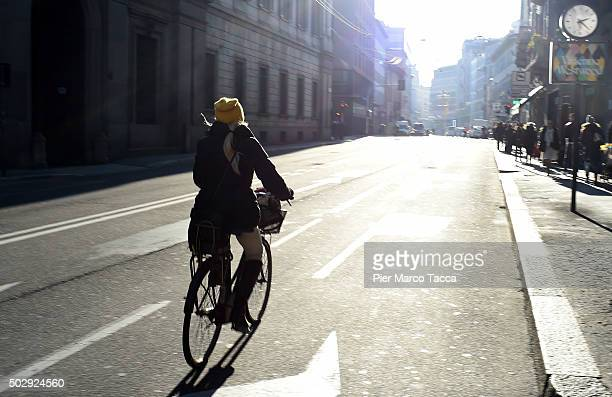 A woman rides a bicycle in Corso Venezia during the third day of a traffic ban on December 30 2015 in Milan Italy The city of Milan has implemented a...