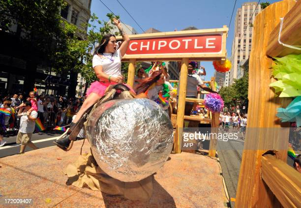 A woman rides a mechanical burrito on a Chipotlethemed float during San Francisco's Gay Pride parade in California on Sunday June 2013 AFP Photo /...