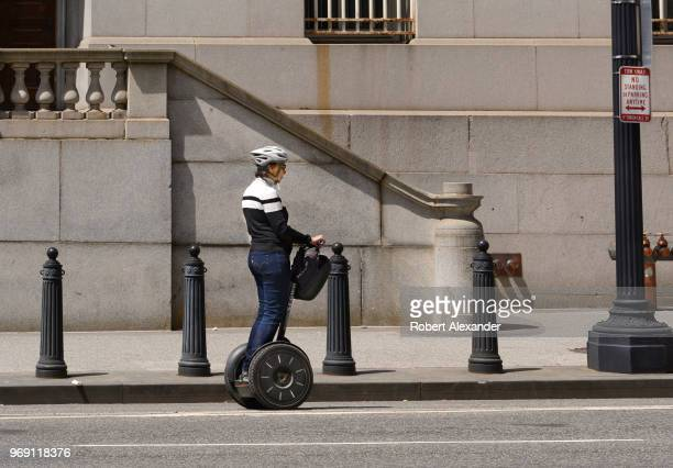 Woman rides a rented Segway along a street in Washington, D.C.