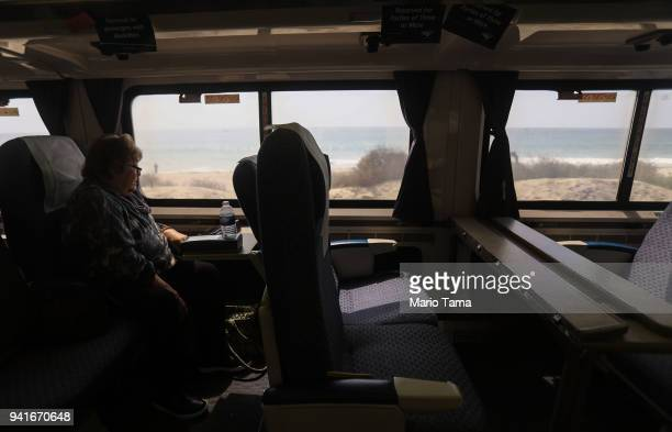 A woman rides an Amtrak train on April 3 2018 in San Clemente California Between 2016 and 2017 public transit ridership fell in the country's seven...