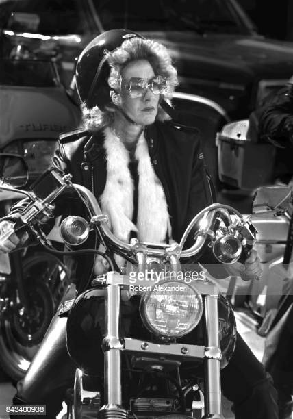 A woman rides her customized motorcycle in Daytona Beach Florida during the city's 1983 Bike Week The annual motorcycle event and rally has attracted...