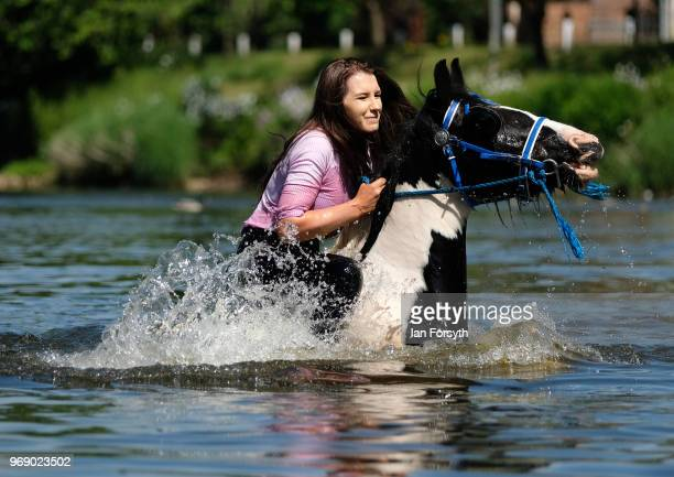 A woman rides her horse through the River Eden on the first day of the Appleby Horse Fair on June 7 2018 in Appleby EnglandThe fair is an annual...
