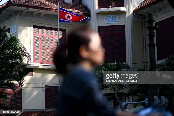 A woman rides past the North Korean embassy in Hanoi on February 6 2019 Communistrun but with capitalist leanings and a friend to both the United...