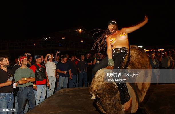 A woman rides the mechanical bull in the Full Throttle Saloon during the 61st annual Sturgis Motorcycle Rally August 11 in Sturgis SD The saloon...