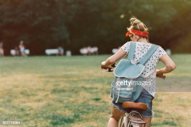 Woman riding a bicycle in the park