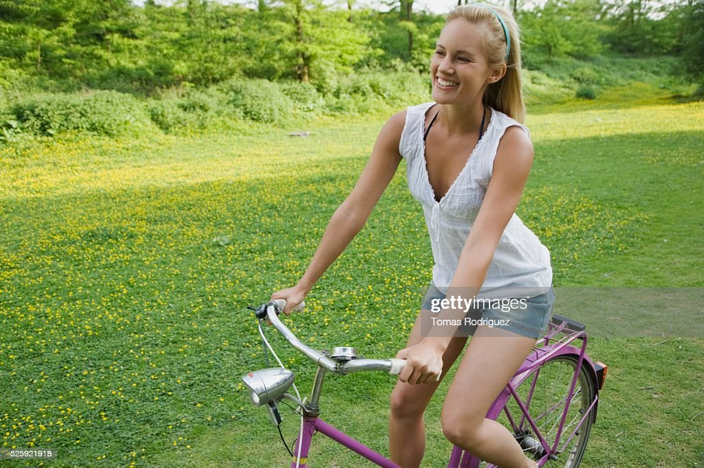Woman Riding a Bike : Stockfoto