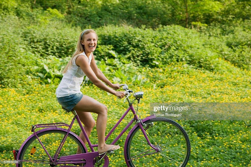 Woman Riding a Bike : Stock Photo