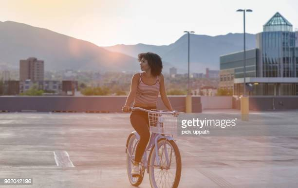 woman riding a bike - salt lake city utah stock pictures, royalty-free photos & images