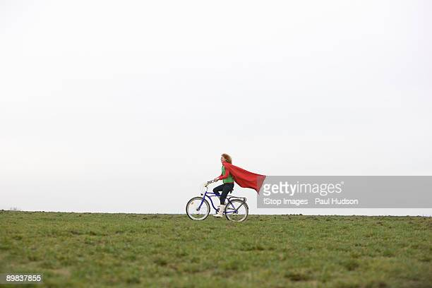 A woman riding a bike through a park