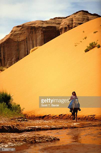 Woman Riding a Horse in the Desert