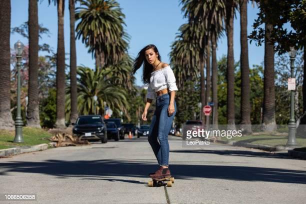 Woman riding a longboard in Los Angeles