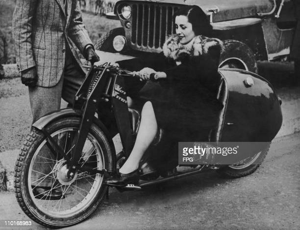A woman riding a new style motorbike built by an engineer from Bologna in 1948 Its design is very low the back of the seat being level with the rear...