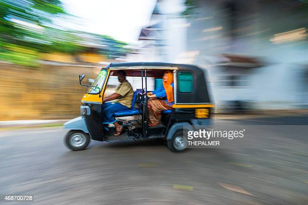 Woman riding a tuk tuk taxi