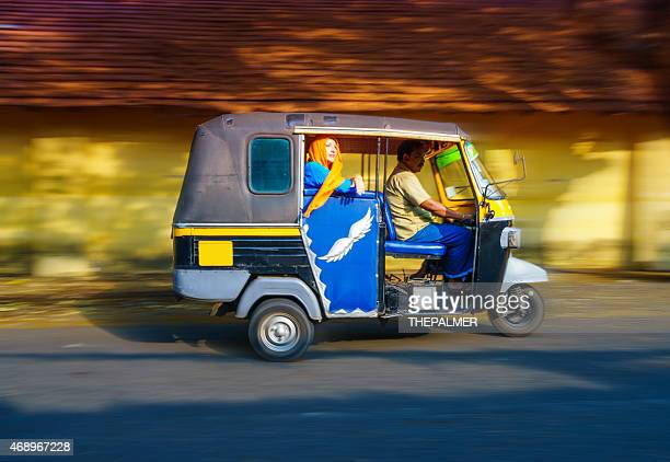 woman riding a tuk tuk taxi - kochi india stock pictures, royalty-free photos & images