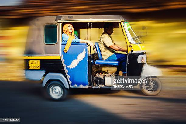 woman riding a tuk tuk taxi - auto rickshaw stock pictures, royalty-free photos & images