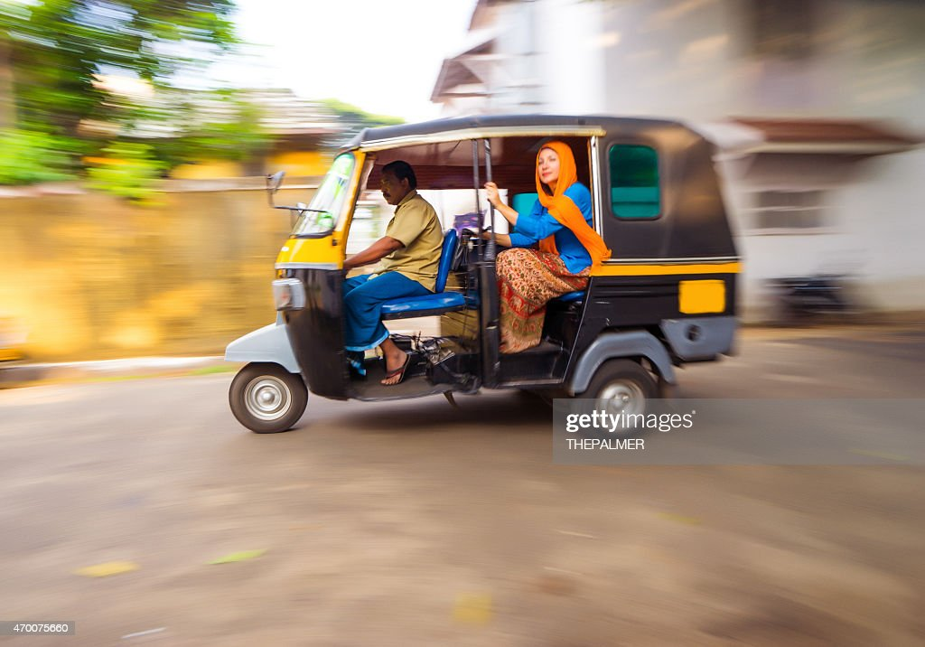 Woman riding a tuk tuk taxi : Stock Photo