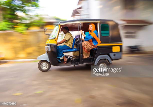 woman riding a tuk tuk taxi - rickshaw stock pictures, royalty-free photos & images