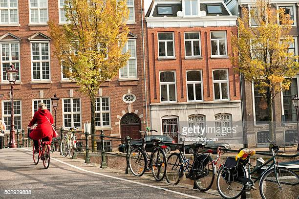 woman riding bicycle in Amsterdam