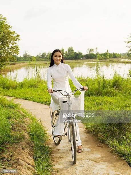 Woman riding bicycle, Vietnam