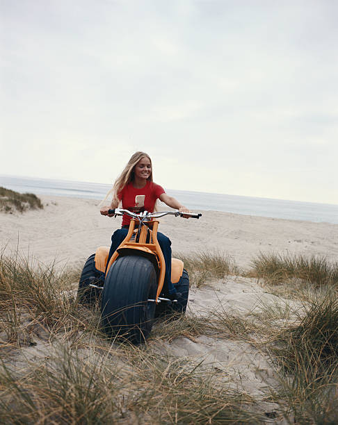 Woman riding bike on beach