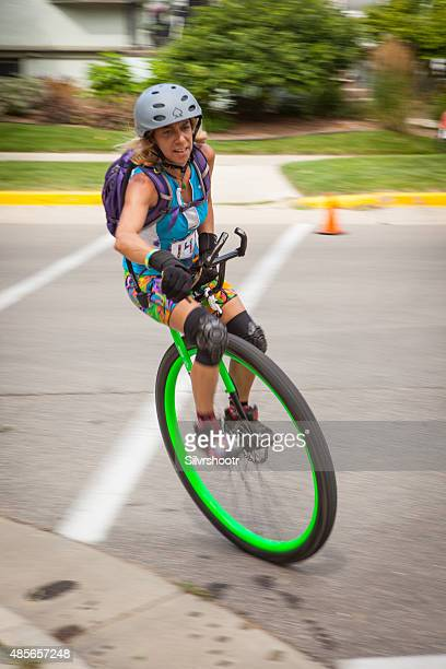 Woman riding her unicycle at a criterium competition
