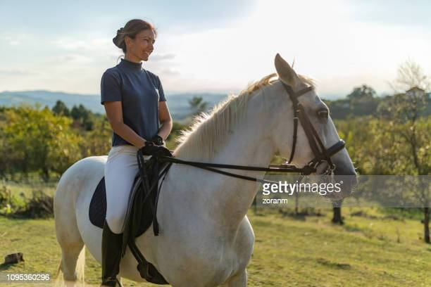 woman riding horse in nature - recreational horseback riding stock pictures, royalty-free photos & images