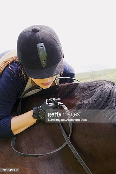 woman riding horse in rural landscape, baden wuerttemberg, germany, europe - alexandra dost stock-fotos und bilder