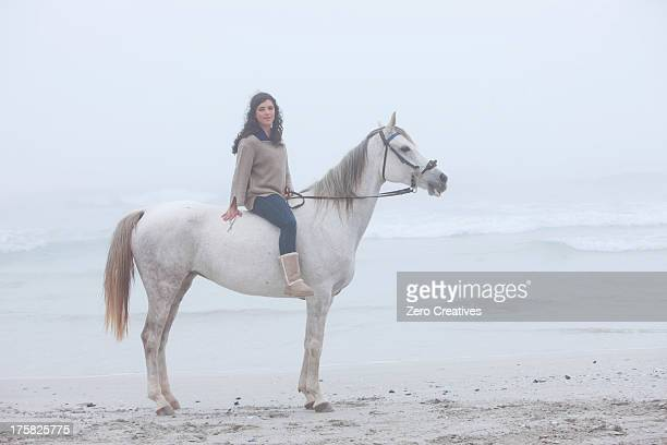 woman riding horse on beach - rein stock pictures, royalty-free photos & images
