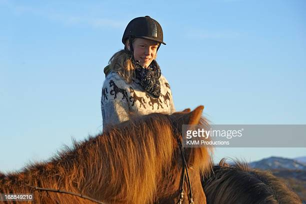 Woman riding horse outdoors