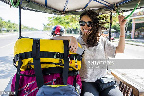 woman riding in auto rickshaw, siem reap, cambodia - auto rickshaw stock pictures, royalty-free photos & images