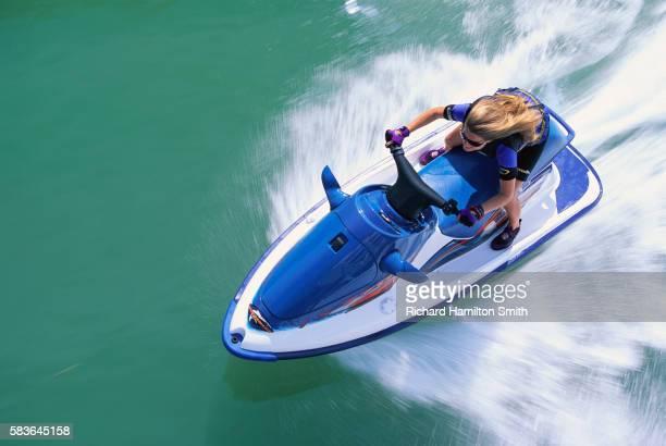 Woman Riding Jet Ski Fast