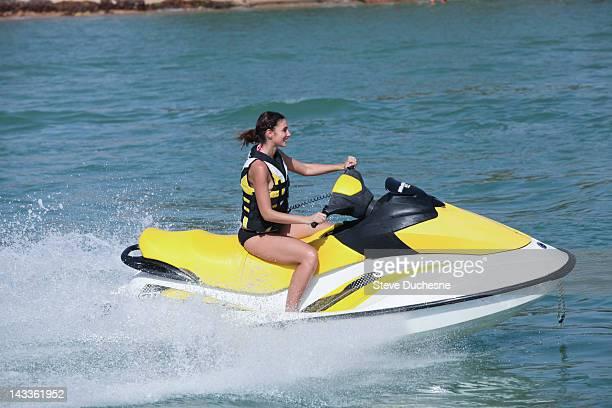 Woman riding jet ski