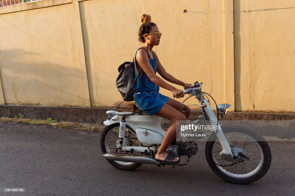 Woman riding motorbikes : Stock Photo