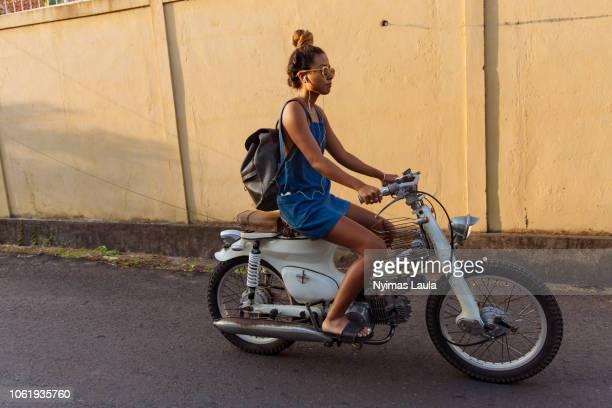 Woman riding motorbikes