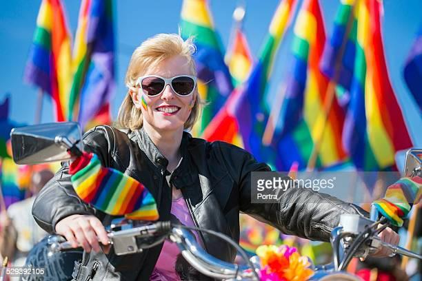Woman riding motorcycle during gay parade