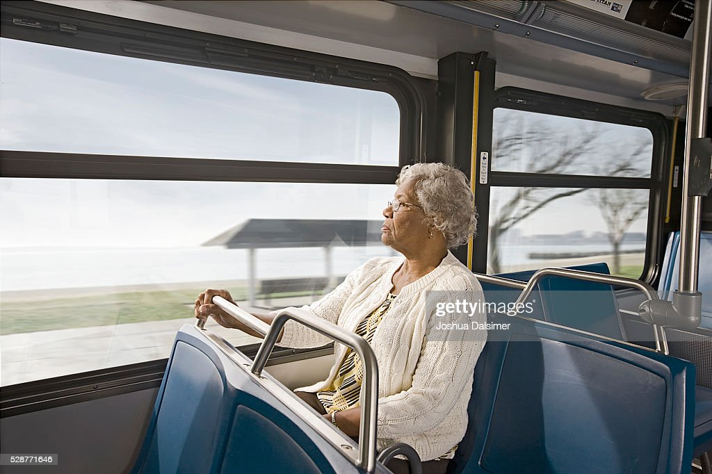 Woman riding on a bus : Stock Photo