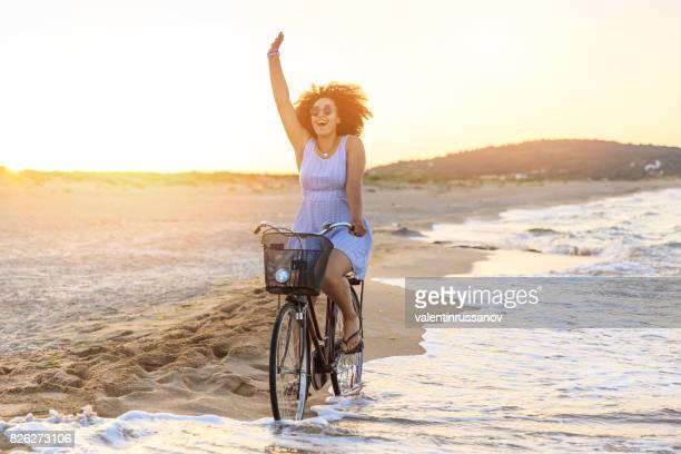 Woman riding on beach