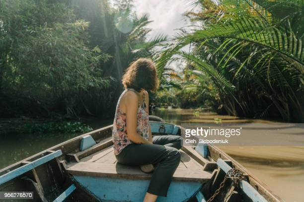 woman riding on boat through mekong delta and floating market - hot women on boats stock pictures, royalty-free photos & images